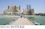Купить «Ajman, UAE - April 11. 2018. Pier leads to tourist hotels.», видеоролик № 29575822, снято 6 апреля 2018 г. (c) Володина Ольга / Фотобанк Лори