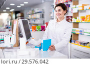 Купить «female pharmacist offering assistance at counter in pharmacy», фото № 29576042, снято 31 января 2017 г. (c) Яков Филимонов / Фотобанк Лори