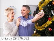 Купить «couple preparing to celebrate in his home Christmas and New Year», фото № 29576382, снято 19 марта 2019 г. (c) Яков Филимонов / Фотобанк Лори