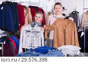 Купить «Happy girl and her mother with purchases», фото № 29576398, снято 21 марта 2018 г. (c) Яков Филимонов / Фотобанк Лори