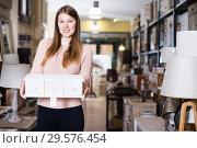 Купить «Woman choosing wooden box», фото № 29576454, снято 15 ноября 2017 г. (c) Яков Филимонов / Фотобанк Лори