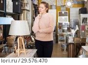 Купить «Female purchaser buying torchere», фото № 29576470, снято 15 ноября 2017 г. (c) Яков Филимонов / Фотобанк Лори