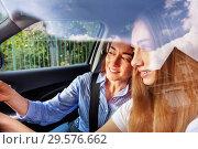 Купить «Portrait of young girl driving car with her mother», фото № 29576662, снято 7 июля 2018 г. (c) Сергей Новиков / Фотобанк Лори