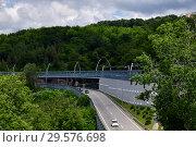 Купить «Sochi, Russia - June 2 2018. Road junction on A-147 highway», фото № 29576698, снято 2 июня 2018 г. (c) Володина Ольга / Фотобанк Лори
