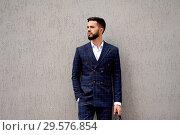 Купить «Businessman style. Men style. Young businessman with bag», фото № 29576854, снято 17 июня 2018 г. (c) Евгений Глазунов / Фотобанк Лори