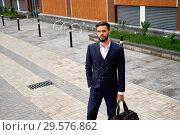 Купить «Businessman style. Men style. Young businessman with bag», фото № 29576862, снято 17 июня 2018 г. (c) Евгений Глазунов / Фотобанк Лори