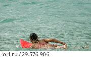 Купить «Attractive surfer woman on a surfboard floating in ocean», видеоролик № 29576906, снято 12 ноября 2017 г. (c) Игорь Жоров / Фотобанк Лори