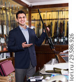 Купить «Handsome adult male in hunting shop with rifle in hands», фото № 29586926, снято 11 декабря 2017 г. (c) Яков Филимонов / Фотобанк Лори