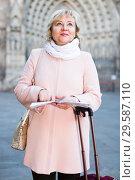 Купить «mature female tourist holding map», фото № 29587110, снято 27 ноября 2017 г. (c) Яков Филимонов / Фотобанк Лори
