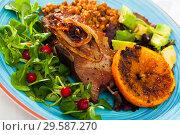 Купить «Tasty cooked fried pork chops with fried orange, avocado and greens», фото № 29587270, снято 17 июля 2019 г. (c) Яков Филимонов / Фотобанк Лори