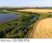 Купить «Natural landscape of central Russia with field, river in August», фото № 29590974, снято 30 июля 2018 г. (c) Володина Ольга / Фотобанк Лори