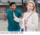 Купить «Couple is quarrelling because of the disagreements between them», фото № 29591170, снято 10 августа 2017 г. (c) Яков Филимонов / Фотобанк Лори