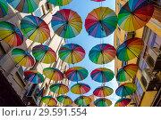 Купить «Alanya, Turkey - October 11, 2018: Colourful umbrellas danging over the top of a Big Bazaar street», фото № 29591554, снято 11 октября 2018 г. (c) Ольга Сейфутдинова / Фотобанк Лори