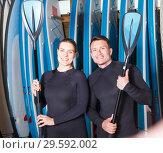 Купить «guy and girl with paddles for surfing», фото № 29592002, снято 30 апреля 2018 г. (c) Яков Филимонов / Фотобанк Лори