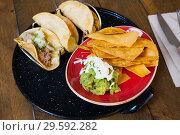 Купить «Guacamole with nachos and tacos», фото № 29592282, снято 19 марта 2019 г. (c) Яков Филимонов / Фотобанк Лори