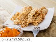Купить «Dish of tasty fried chicken fingers from fillet in sesame served at plate», фото № 29592322, снято 16 января 2019 г. (c) Яков Филимонов / Фотобанк Лори
