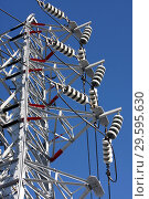 Купить «Опора ЛЭП с высоковольтными проводами на фоне голубого неба», фото № 29595630, снято 30 января 2010 г. (c) Александр Гаценко / Фотобанк Лори