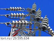 Купить «Опора ЛЭП с высоковольтными проводами на фоне голубого неба», фото № 29595634, снято 30 января 2010 г. (c) Александр Гаценко / Фотобанк Лори
