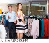 Купить «Married couple chooses a trendy dress», фото № 29595910, снято 11 апреля 2017 г. (c) Яков Филимонов / Фотобанк Лори