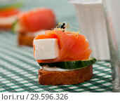 Купить «Toasted bread with salmon, soft cheese and cucumber», фото № 29596326, снято 22 марта 2019 г. (c) Яков Филимонов / Фотобанк Лори