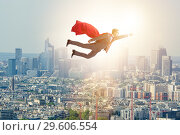 Купить «The superhero businessman flying over the city», фото № 29606554, снято 19 мая 2019 г. (c) Elnur / Фотобанк Лори