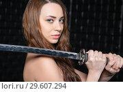 Купить «Portrait of a woman with a katana», фото № 29607294, снято 15 января 2016 г. (c) Сергей Сухоруков / Фотобанк Лори