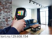 Купить «thermal imaging camera inspection of building. check temperature», фото № 29608154, снято 23 декабря 2018 г. (c) Дмитрий Калиновский / Фотобанк Лори