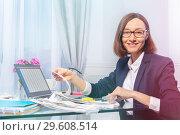 Купить «Businesswoman working with papers in the office», фото № 29608514, снято 16 июня 2018 г. (c) Сергей Новиков / Фотобанк Лори