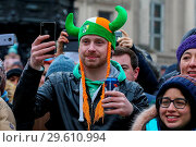 Купить «Performers take part in the annual St. Patrick's Day Parade in central London, as tens of thousands of people watch the parade. Saint Patrick's Day, or...», фото № 29610994, снято 18 марта 2018 г. (c) age Fotostock / Фотобанк Лори