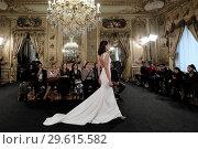 Купить «Madrid Fashion Week Atelier Couture - Amarca - Catwalk Featuring: Model Where: Madrid, Spain When: 15 Mar 2018 Credit: Oscar Gonzalez/WENN.com», фото № 29615582, снято 15 марта 2018 г. (c) age Fotostock / Фотобанк Лори