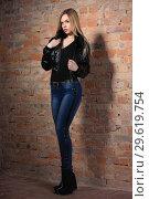 Купить «Lovely woman posing near a brick wall.», фото № 29619754, снято 22 февраля 2016 г. (c) Сергей Сухоруков / Фотобанк Лори