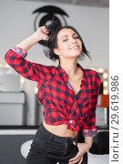 Купить «Playful brunette dressed a plaid shirt.», фото № 29619986, снято 8 января 2016 г. (c) Сергей Сухоруков / Фотобанк Лори
