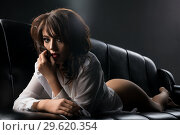Купить «Brunette in white shirt on the sofa portrait», фото № 29620354, снято 22 ноября 2017 г. (c) Гурьянов Андрей / Фотобанк Лори