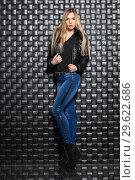 Купить «Alluring young lady posing in the studio», фото № 29622686, снято 22 февраля 2016 г. (c) Сергей Сухоруков / Фотобанк Лори
