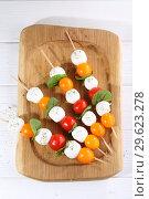 Mozzarella with cherry tomatoes. Стоковое фото, фотограф Марина Володько / Фотобанк Лори