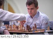 Купить «Чемпион мира Magnus Carlsen, Норвегия (справа) на чемпионате мира по быстрым шахматам в Санкт-Петербурге», фото № 29623350, снято 28 декабря 2018 г. (c) Stockphoto / Фотобанк Лори