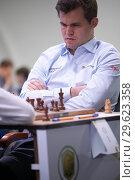 Купить «Чемпион мира Magnus Carlsen, Норвегия на чемпионате мира по быстрым шахматам в Санкт-Петербурге», фото № 29623358, снято 28 декабря 2018 г. (c) Stockphoto / Фотобанк Лори
