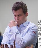 Купить «Чемпион мира Magnus Carlsen, Норвегия на чемпионате мира по быстрым шахматам в Санкт-Петербурге», фото № 29623362, снято 28 декабря 2018 г. (c) Stockphoto / Фотобанк Лори