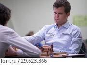 Купить «Чемпион мира Magnus Carlsen, Норвегия (справа) на чемпионате мира по быстрым шахматам в Санкт-Петербурге», фото № 29623366, снято 28 декабря 2018 г. (c) Stockphoto / Фотобанк Лори