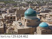 Купить «Skyline, Pahlavon Mahmud Mausoleum, Khiva, Uzbekistan.», фото № 29624462, снято 28 января 2020 г. (c) age Fotostock / Фотобанк Лори