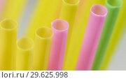 Купить «Top view of colorful straw on the rotation table», видеоролик № 29625998, снято 23 июля 2019 г. (c) Dzmitry Astapkovich / Фотобанк Лори