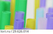 Купить «Top view of colorful straw on the rotation table», видеоролик № 29626014, снято 23 июля 2019 г. (c) Dzmitry Astapkovich / Фотобанк Лори