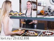 Купить «portrait of young happy woman baker with tasty cakes and rolls», фото № 29632898, снято 22 апреля 2017 г. (c) Яков Филимонов / Фотобанк Лори