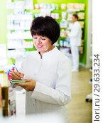 Купить «Woman pharmacist in pharmacy», фото № 29633234, снято 21 октября 2016 г. (c) Яков Филимонов / Фотобанк Лори