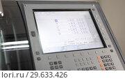 Купить «Process of entering parameters on panel of dental milling machine», видеоролик № 29633426, снято 29 декабря 2018 г. (c) Andriy Bezuglov / Фотобанк Лори