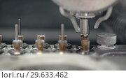 Купить «Closeup view at moving hi-speed spindle of dental milling machine», видеоролик № 29633462, снято 29 декабря 2018 г. (c) Andriy Bezuglov / Фотобанк Лори