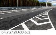 Купить «White road lines on the highway in sunny day», фото № 29633602, снято 7 августа 2018 г. (c) FotograFF / Фотобанк Лори