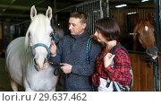 Купить «Portrait of man and woman with roan horse», фото № 29637462, снято 26 ноября 2018 г. (c) Яков Филимонов / Фотобанк Лори