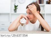 Купить «woman sitting lonely indoors», фото № 29637554, снято 14 ноября 2019 г. (c) Яков Филимонов / Фотобанк Лори