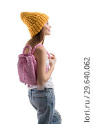 Купить «Pretty teenager with knitted bag profile shot», фото № 29640062, снято 21 декабря 2018 г. (c) Гурьянов Андрей / Фотобанк Лори